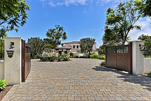 A private gated paver-stone entry