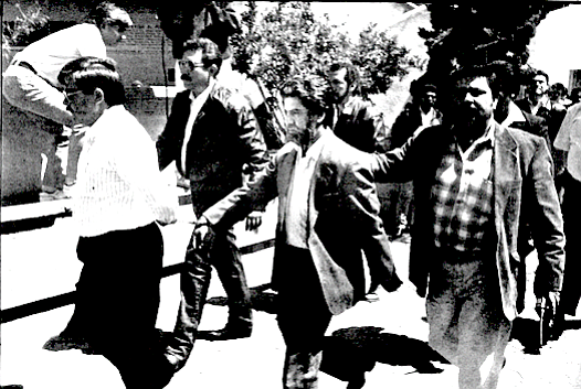Palestina, apprehended in Los Angeles, being returned to Mexico.