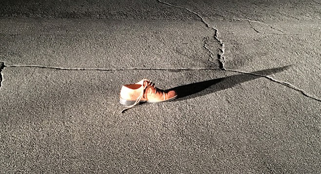 Shoe in the middle of Glen Street, October 2