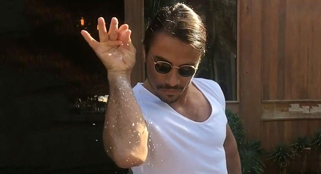 Salt Bae mid-sprinkle
