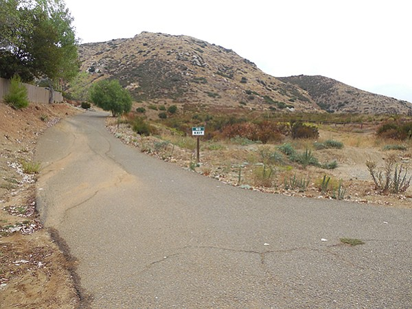 """Trailhead.  Walk toward a sign reading """"NO EXIT."""""""