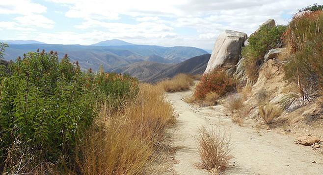 The dark pyramid-shaped Viejas Mountain is visible east of El Cajon Mountain.