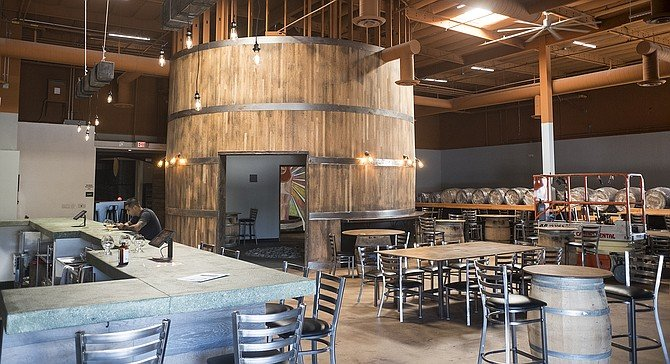 A large barrel shaped space is the centerpiece of Wild Barrel's tasting room