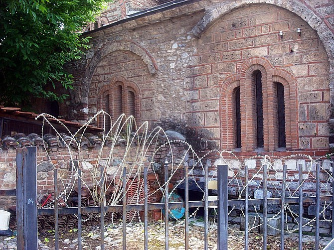 With some underlying tension remaining between ethnic groups, barbed wire surrounds many churches in Kosovo.
