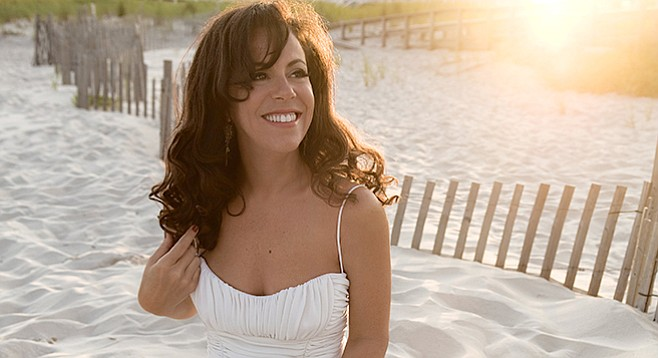 If you see Bebel Gilberto shivering on the beach, be so kind as to give her your shirt.