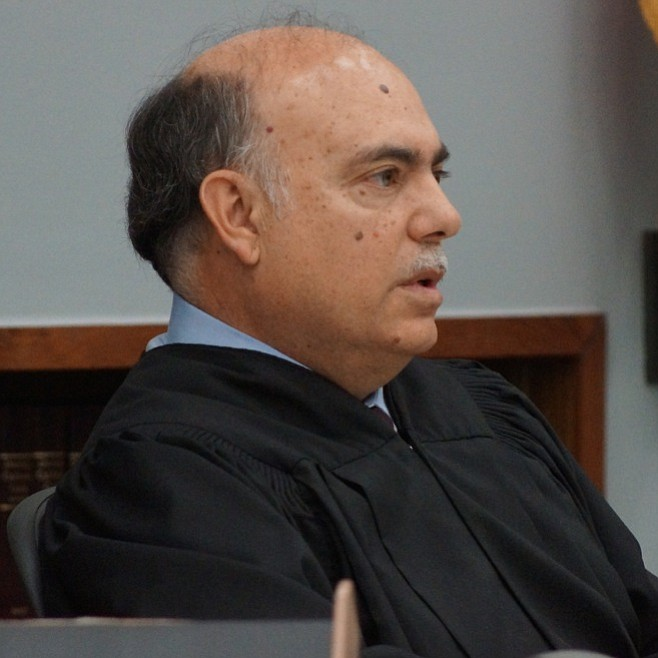 Judge Carlos Armour wants the defendant to pay for his attorney. Photo by Eva.