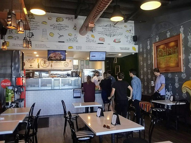 High school kids and businessmen order ahead and take their sandwiches to go at Grater Grilled Cheese.