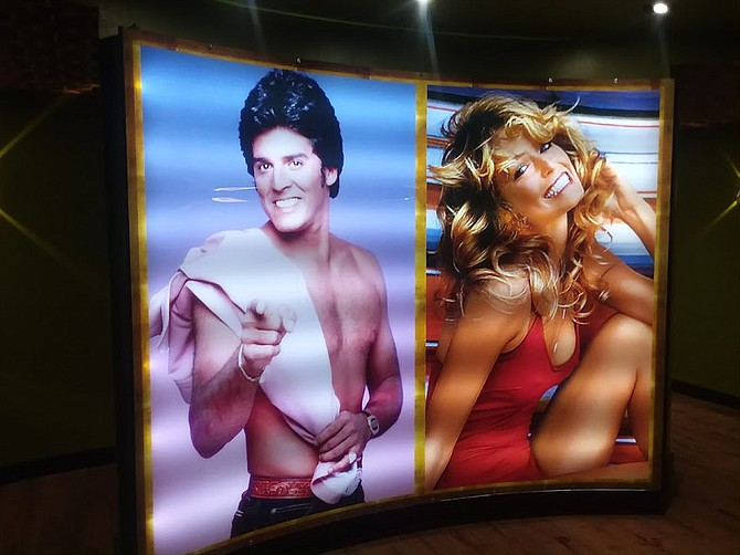 Posters of 70s TV stars are scattered around the Smoking Gun.