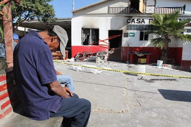 Dejected resident outside El Refugio nursing home