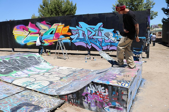 The 10,000-square-foot lot still has the large paintable walls standing and the skateboard ramp intact.