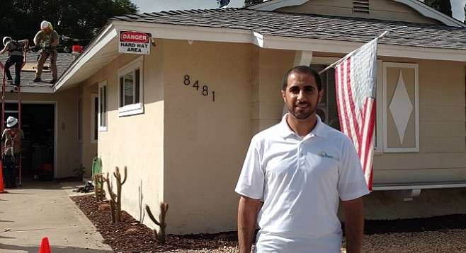 Mohamed Hauter outside a GRID Alternatives free solar installation
