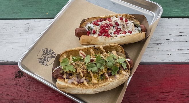 Gourmet hot dogs loaded with toppings