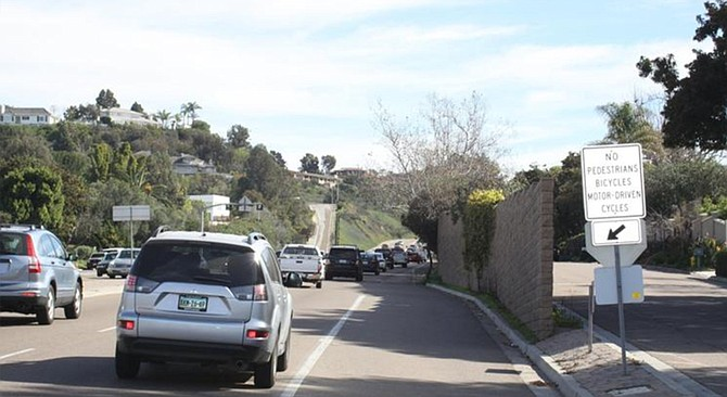 The wall on Ardath Road that shields two houses from La Jolla Parkway traffic noise