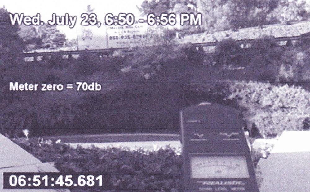 Noise-meter photo taken from resident's window reads 74 decibels