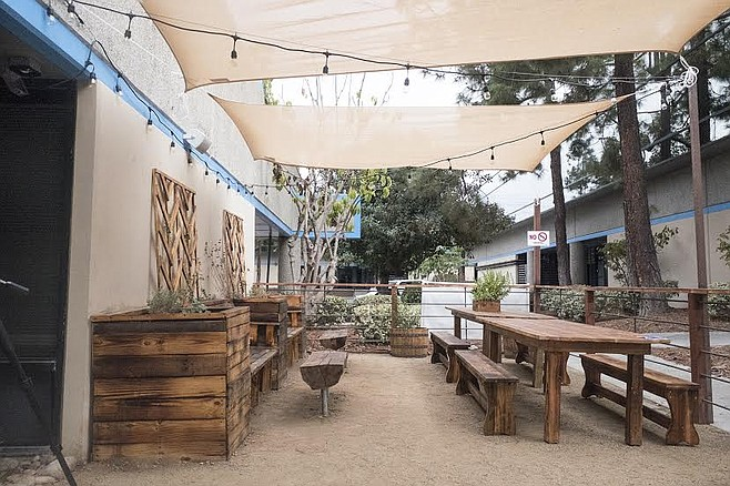 Serpentine Cider's exterior sports a desert-oasis aesthetic.