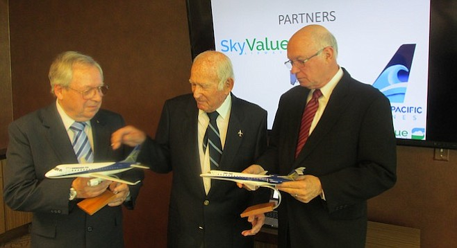 California Pacific Airlines' COO Paul Hook, founder Ted Vallas, and CEO Darrell Richardson show off models of the Embraer jets they recently purchased.