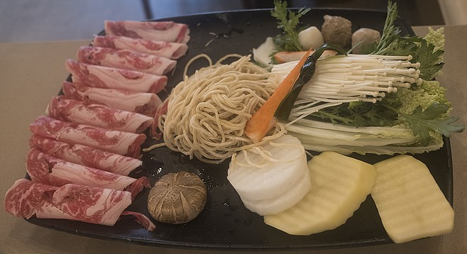 A tray of hot pot add-ins, prior to being tossed into boiling broth.