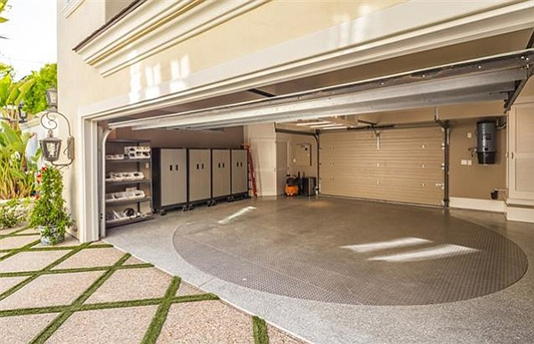 Two garages provide parking for up to five cars