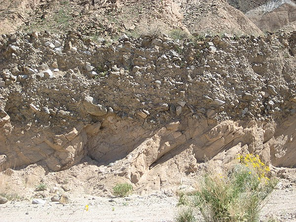 A noticeable change in sedimentary beds called an angular unconformity appears.