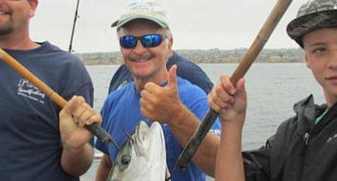 Captain Joe Cacciola (center)