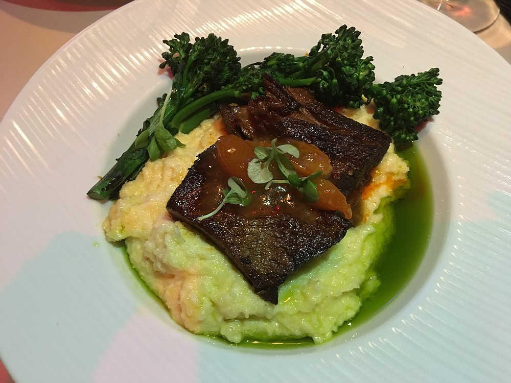 The braised short rib is flavorful, especially with the garlic polenta and kumquat jam.