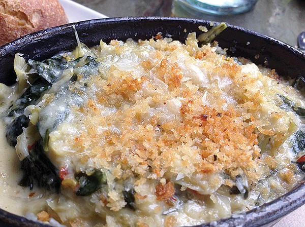 A baked artichoke and spinach cassoulet, with parmesan cheese inside and breadcrumbs on top.