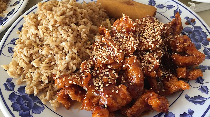 The sesame chicken was sliced thin, lightly breaded, fried, and slathered in a tangy sauce.