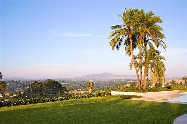 Just under one acre of manicured hilltop grounds