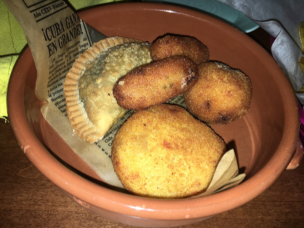 The bocaditos platter included turnovers, plantain chips, and croquettes.