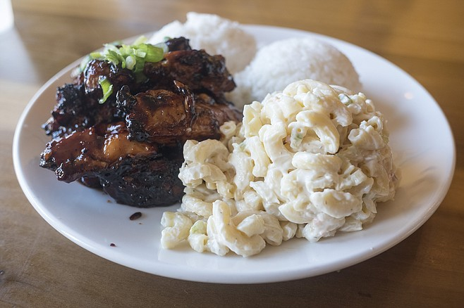 A Hawaiian plate lunch, with pile of charred chicken, plus scoops of rice and macaroni salad.