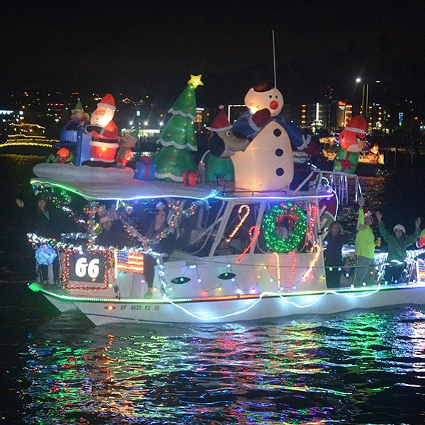 Eighty decorated boats sail the bay