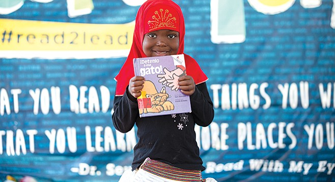 Traveling Stories volunteers read with children to help improve literacy skills and inspire a love of stories.
