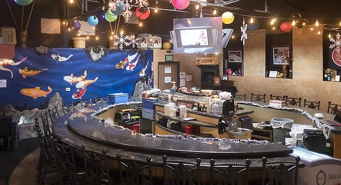 A subterranean sushi bar inside an islander restaurant