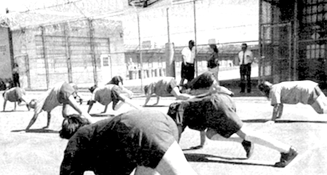 Girls in custody exercising. 91 percent of parolees are re-arrested within three years.