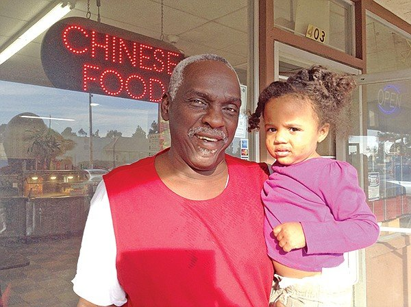 """W.C. and Zaire. """"My daughter had 17 kids. You never get lonely in our family."""""""