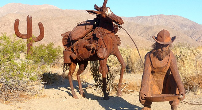 Prospector and mule now near the saguaro