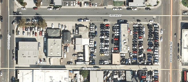 The project is proposed for the corner of Mission Gorge and Glacier in a commercial area with repair shops, a car wash, and a tow yard.