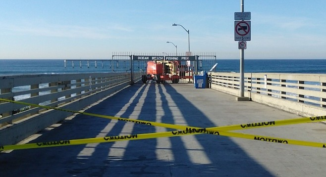 The pier has been closed for a day. City workers say the job will be completed tomorrow.