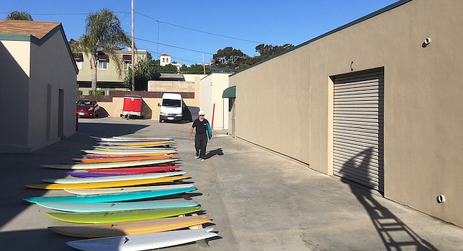 Skip Frye with some of boards he has made