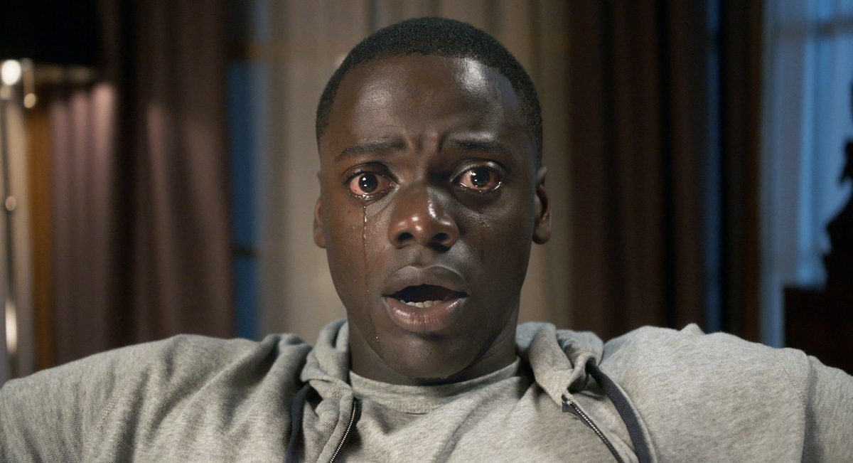 Get Out: No, he's not reading Internet comments. But the facial expression is right for it.