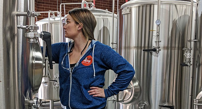 Former San Diego brewer Carli Smith gets familiar with her new brewhouse in Charlotte, NC.