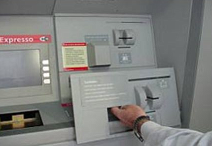 The scammers' skimmers fit right over the bank's card reader.
