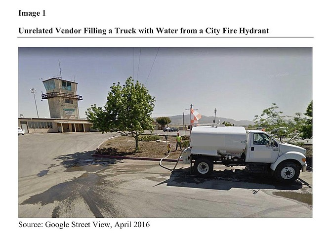"""Photo of """"unrelated vendor"""" filling water truck from city hydrant"""
