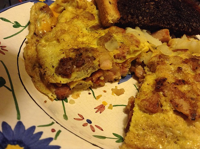 Meat Lover omelet. Sausages rule!