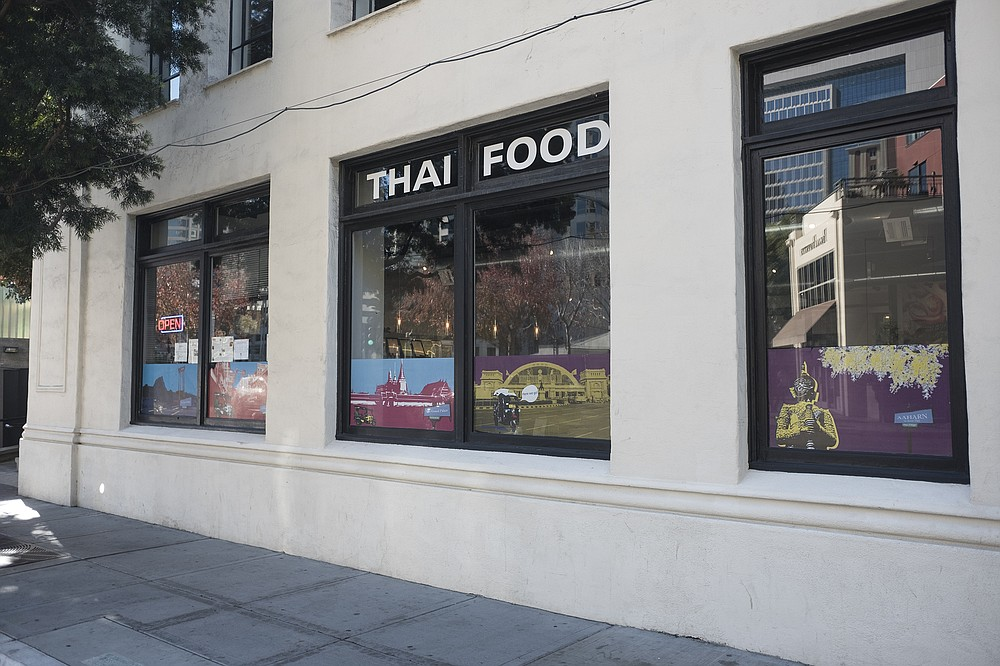 A nondescript exterior for a downtown Thai restaurant, pronounced Ah-harn.