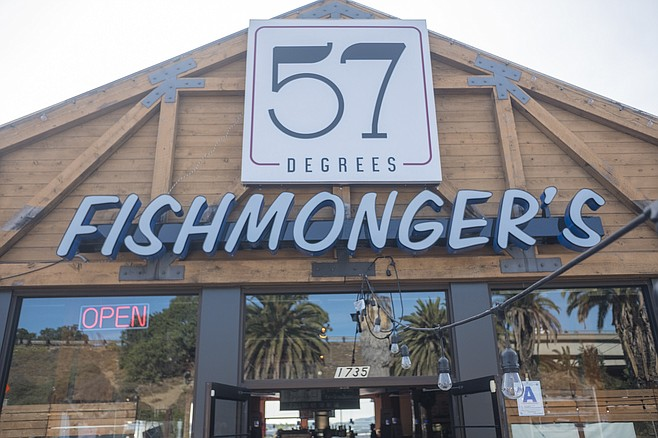 A wine bar and seafood restaurant, sharing a large space off the freeway.