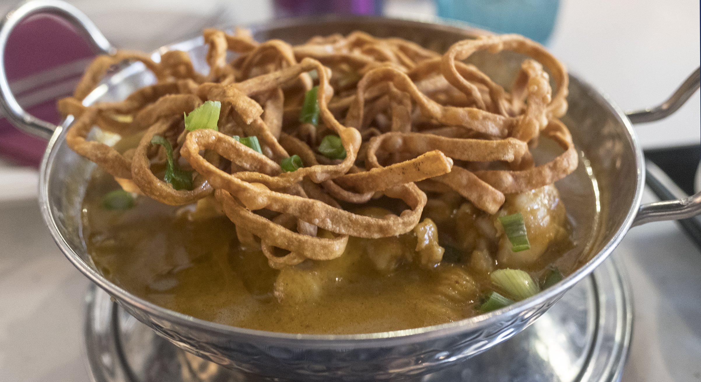 Khao soi: crispy noodles add to the fun of a soupy noodle curry dish