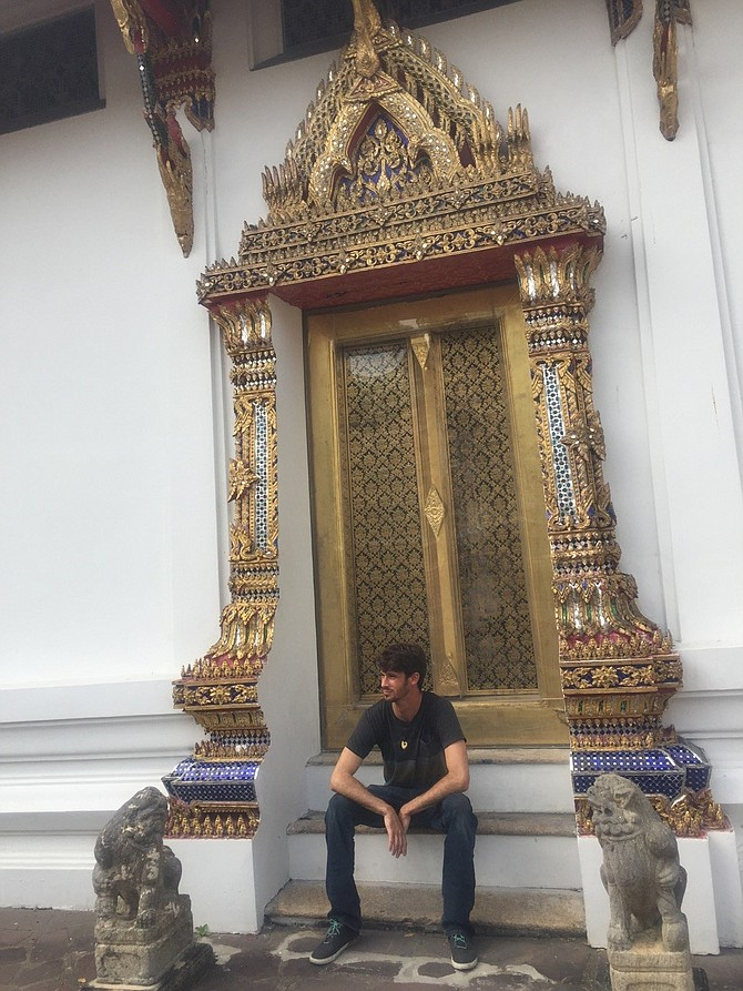 Elan Saltman sitting on a temple stoop