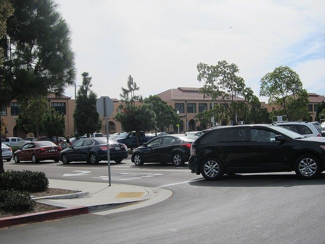 Traffic in parking lot on Sunday after 10 a.m. service.