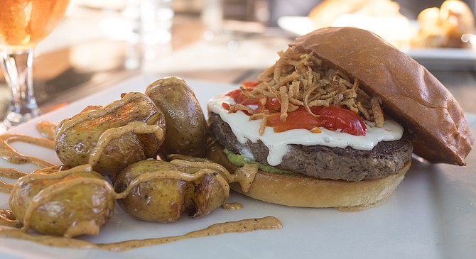 Stone World Bistro's plating of the plant-based Impossible Burger